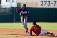 Darnell Sweeney #9 of the Rancho Cucamonga Quakes bobbles the ball after forcing out Delino DeShields #3 of the Lancaster JetHawks at second base during a game at The Hanger on August 25, 2013 in Lancaster, California. Lancaster defeated Rancho Cucamonga, 7-1. (Larry Goren/Four Seam Images)
