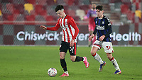 Alex Gilbert of Brentford in possession as Middlesbrough's Hayden Hackney looks on during Brentford vs Middlesbrough, Emirates FA Cup Football at the Brentford Community Stadium on 9th January 2021