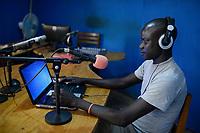 UGANDA, Arua, radio station Radio Pacis, Radio reporter in Moyo
