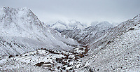 A small village is nestled among the Himalayas after a fresh snow.