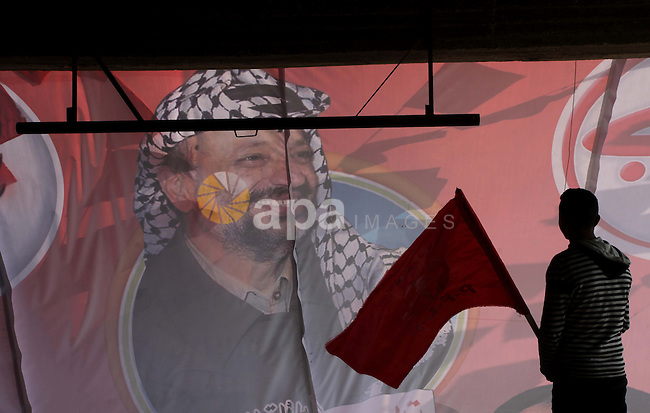 Palestinians take part in a rally in Gaza City on December 7, 2013, marking the 46th anniversary of the founding of the Popular Front for the Liberation of Palestine (PFLP), a Palestinian Marxist revolutionary organization established in 1967. Photo by Ashraf Amra