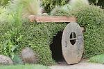 Culvert provides crawl through entertainment in the Children's Garden at Oregon Gardens.  Oregon Gardens, Silverton, Oregon, USA, an 80 acre botanical garden in the Willamette Valley.  Windy day.  HDR image.