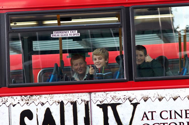 © John Angerson <br /> Passengers riding the vast London Bus route near Great Portland Street.<br /> <br /> +44 (0) 7767 822828