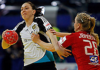 BELGRADE, SERBIA - DECEMBER 15:  Victoria Zhilinskayte of Russia (L) is challenged by Stine Jorgensen (R) of Denmark during the Women's European Handball Championship 2012 fifth place match between Denmark and Russia at Arena Hall on December 15, 2012 in Belgrade, Serbia. (Photo by Srdjan Stevanovic/Getty Images)