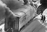 Electrical fire destroys VIA sleeper car. Firefighters battle a stubborn blaze in a VIA Rail sleeper car yesterday in a Canadian National Railway marshalling yard of New Toronto St. in Etobicoke. A short-circuit in the car's battery system was blamed for the blaze; which broke out around 2.30 p.m. Damage totalled about $1 million; according to police officers. Sections of the car's roof had to be cut away with a power saw.<br /> <br /> Photo : Boris Spremo - Toronto Star archives - AQP
