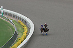 July 22 2010: Jockey Rafael Bejarano is lead by an outrider after inspecting the polytrack racing surface following an early morning closure at Del Mar Race Track in Del Mar CA.