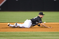 Charlotte Knights third baseman Matt Davidson (22) can't come up with this ground ball during the game against the Columbus Clippers at BB&T BallPark on May 27, 2015 in Charlotte, North Carolina.  The Clippers defeated the Knights 9-3.  (Brian Westerholt/Four Seam Images)
