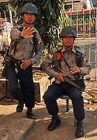 Armed police and soldiers guard a bridge in central Rangoon, Burma, Dec 2008.  The military remains prominent in every day life and guard all strategic points within the city.<br />