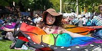 Girl spinning with multicolored butterfly wings, NW Folklife Festival, Seattle, WA, USA.
