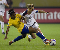USA forward (13) Kristine Lilly is tackled by Brazil defender (2) Elaine. Brazil (BRA) defeated the United States (USA) 4-0 during the FIFA Women's World Cup China 2007 at Hangzhou Dragon Stadium in Hangzhou, China, on September 27, 2007. Brazil advances to the finals, while the United States will play in the third place game on September 30th.
