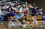 SIOUX FALLS, SD - MARCH 7: RaVon Nero #2 of the UMKC Kangaroos drives to the basket between Danni Nichols #4 and Carla Flores #0 of the Western Illinois Leathernecksduring the Summit League Basketball Tournament at the Sanford Pentagon in Sioux Falls, SD. (Photo by Dave Eggen/Inertia)