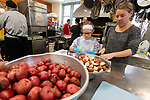 TORRINGTON,  CT-122519JS02- Volunteers Erin Saluis of Easton, Mass., and her daughter Sadie Borushko, 10, help cut potatoes as they prep for the annual Christmas Day dinner Wednesday at the Torrington Soup Kitchen. Saluis, who grew up in Torrington, was back home visiting friends and family. <br /> Jim Shannon Republican-American