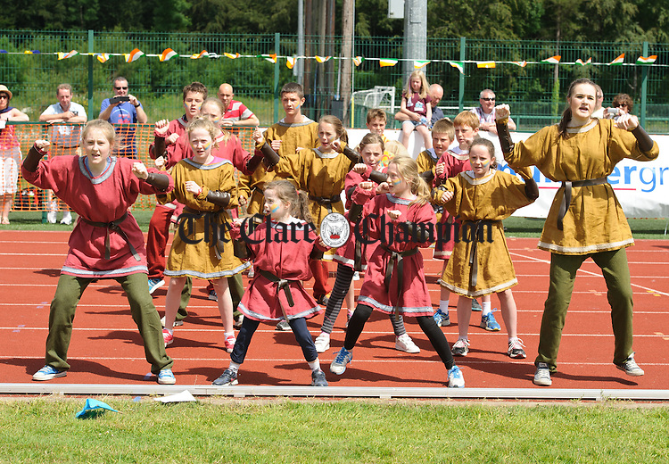 """Members of the Derg group from Killaloe perform their Brian Boru """"Haka"""" in in the parade before the  Clare Community Games Athletic Finals in Lees Road, Ennis. photograph by John Kelly."""