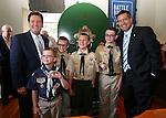 From left, Lt. Gov. Brian Krolicki, Nate Crossman, 9, Jacob Crossman, 11, Kyle Holloway, 11, Gabe Crossman, 12, and Gov. Brian Sandoval pose after a ceremony marking the beginning of production of the third medallion in the four-part Sesquicentennial series, at the Nevada State Museum in Carson City, Nev., on Friday, May 30, 2014. <br /> Photo by Cathleen Allison