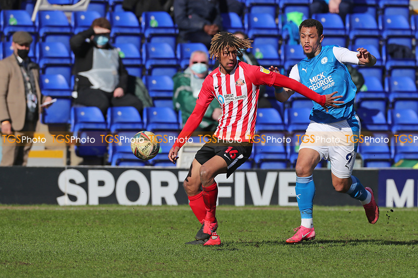 Sunderland's Dion Sanderson and Peterborough United's Jonson Clarke-Harris during Peterborough United vs Sunderland AFC, Sky Bet EFL League 1 Football at London Road on 5th April 2021