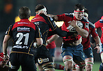 Robin Copeland of Munster Rugby is tackled by Second row Rynard Landman of Newport Gwent Dragons.<br /> <br /> Guinness Pro 12<br /> Newport Gwent Dragons v Munster Rugby<br /> Rodney Parade<br /> 21.11.14<br /> ©Steve Pope-SPORTINGWALES