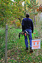 00105-049.10 Bowhunting: Archer walks trail toward archery practice range during early fall.  Danger sign.  Warning.