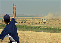 """Isreal Tanks apear during Hamas demonstration in the Karni crossing east of Gaza City that injured 10 people and killing people by the Israeli army on May 22, 2008 """"photo by Thair alhassany"""""""