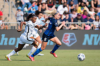 CARY, NC - SEPTEMBER 12: Crystal  Dunn #19 of the Portland Thorns and Denise O'Sullivan #8 of the NC Courage chase the ball during a game between Portland Thorns FC and North Carolina Courage at Sahlen's Stadium at WakeMed Soccer Park on September 12, 2021 in Cary, North Carolina.