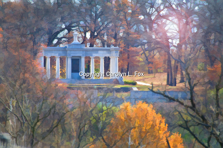 An old building can be seen among the trees in Kansas City, Missouri.  You can see the sun shining through the trees.  This picture has been given an artsy effect.  It is available without the effect if you want it that way.