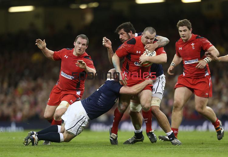 Scottish pair Scott Lawson and Jim Hamilton tackle Wales hooker Ken Owens.<br /> RBS 6 Nations 2014<br /> Wales v Scotland<br /> Millennium Stadium<br /> <br /> 15.03.14<br /> <br /> ©Steve Pope-SPORTINGWALES