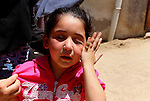 "Shams, 5, the daughter of Palestinian Salah al-Astal, a member of the Islamic Jihad's armed wing -the Al-Quds Brigades- who died after a tunnel collapse in the Gaza Strip, cries during his funeral in Khan Younis in the southern Gaza Strip on July 19, 2016. The Al-Quds Brigades announced in a statement that Salah al-Astal had died during the ""collapse of a resistance tunnel,"" a term used by Islamic Jihad, Hamas and other Palestinian militant factions to refer to tunnels used in the conflict with Israel. Since January 26, at least 14 Gazans have been killed in at least seven separate tunnel collapses. Photo by Abed Rahim Khatib"
