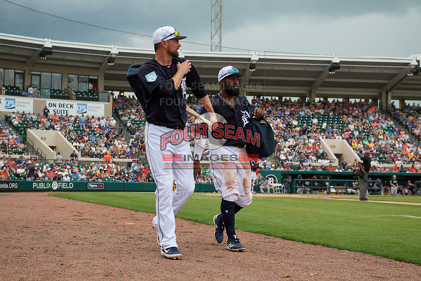 Detroit Tigers Jordy Mercer (left) and Josh Harrison (right) walk to the clubhouse after being substituted for during a Grapefruit League Spring Training game against the New York Yankees on February 27, 2019 at Publix Field at Joker Marchant Stadium in Lakeland, Florida.  Yankees defeated the Tigers 10-4 as the game was called after the sixth inning due to rain.  (Mike Janes/Four Seam Images)