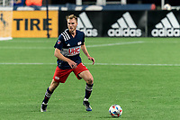 FOXBOROUGH, MA - APRIL 24: Henry Kessler #4 of New England Revolution looks to pass during a game between D.C. United and New England Revolution at Gillette Stadium on April 24, 2021 in Foxborough, Massachusetts.