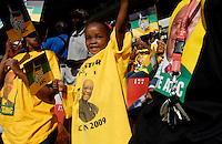 Young people wear Jacob Zuma t-shirts and wave ANC falgs at an African National Congress (ANC) election rally held at the Ellis Park Stadium in Johannesburg..
