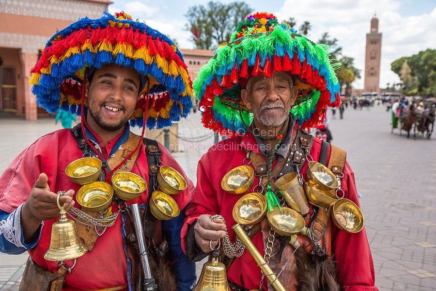 Marrakesh, Morocco.  Two Water Sellers (Guerrab) in the Place Jemaa El-Fna.