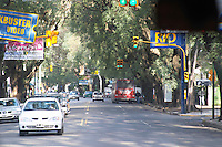 A suburban street in Buenos Aires with cars, traffic lights local busses, in the Acassuso district. Buenos Aires Argentina, South America