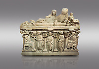 "Roman relief sculpted sarcophagus of Aurelia Botiano and Demetria depicted reclining on the lid, 2nd century AD, Perge Inv 1.35.99. Antalya Archaeology Museum, Turkey.<br /> <br /> it is from the group of tombs classified as. ""Columned Sarcophagi of Asia Minor"". The lid of the sarcophagus is sculpted into the form of a ""Kline"" style Roman couch on which lie Julianus &  Philiska. This type of Sarcophagus is also known as a Sydemara Type of Tomb.. Against a grey background."