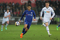 (L-R) Eden Hazard of Chelsea closely followed by Alfie Mawson of Swansea City during the Premier League game between Swansea City v Chelsea at the Liberty Stadium, Swansea, Wales, UK. Saturday 28 April 2018