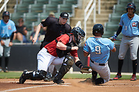 Jose Almonte (9) of the Hickory Crawdads is tagged out at home plate by Kannapolis Intimidators catcher Gunnar Troutwine (37) as home plate umpire Mitch Leikam looks on at Kannapolis Intimidators Stadium on June 2, 2019 in Kannapolis, North Carolina. The Intimidators defeated the Crawdads 4-3. (Brian Westerholt/Four Seam Images)