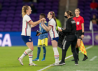 ORLANDO, FL - JANUARY 18: Samantha Mewis #3 subs out for Rose Lavelle #16 of the USWNT during a game between Colombia and USWNT at Exploria Stadium on January 18, 2021 in Orlando, Florida.