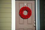 Brown Door with Red Wreath