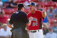 Hickory Crawdads manager Bill Richardson #24 argues a call with home plate umpire Blake Selter during a South Atlantic League game against the Greensboro Grasshoppers at  L.P. Frans Stadium July 10, 2010, in Hickory, North Carolina.  Photo by Brian Westerholt / Four Seam Images