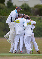Johnsonville players celebrate victory on day three of the Pearce Cup Wellington men's cricket final between Johnsonville and Taita at Alex Moore Park in Johnsonville, New Zealand on Sunday, 28 March 2021. Photo: Dave Lintott / lintottphoto.co.nz