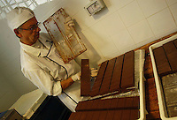 Artigiani a San Lorenzo , quartiere storico di Roma. Craftsmen in San Lorenzo, historic district of Rome. .SAID. Antica fabbrica di cioccolata, dal 1923, nello storico quartiere di San Lorenzo. Produzione di cioccolatini, torroni, uova di Pasqua..Old chocolate factory from 1923, in the historical district of San Lorenzo. Production of chocolate, nougat, Easter eggs....