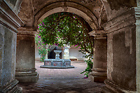 Antigua, Guatemala.  Capuchinas Convent, Built 1736.  Ground-level Corridor and Courtyard with Fountain.