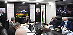 Palestinian Prime Minister Mohammed Ishtayeh chairs the weekly meeting of his government, in the West Bank city of Ramallah on October 4, 2021. Photo by Prime Minister Office