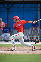 Philadelphia Phillies Yahir Gurrola (21) follows through on a swing during an Instructional League game against the Toronto Blue Jays on October 7, 2017 at the Englebert Complex in Dunedin, Florida.  (Mike Janes/Four Seam Images)