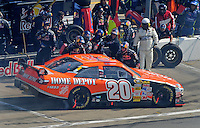Sept. 28, 2008; Kansas City, KS, USA; Nascar Sprint Cup Series crew members for Brian Vickers (not pictured) confront driver Tony Stewart after a pit road incident during the Camping World RV 400 at Kansas Speedway. Mandatory Credit: Mark J. Rebilas-