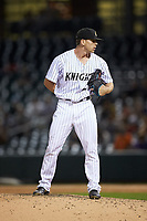 Charlotte Knights relief pitcher Ian Hamilton (29) looks to his catcher for the sign against the Toledo Mud Hens at BB&T BallPark on April 24, 2019 in Charlotte, North Carolina. The Knights defeated the Mud Hens 9-6. (Brian Westerholt/Four Seam Images)