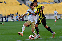 Wellington Phoenix' Sarpreet Singh and Newcastle Jets' Steven Ugarkovic in action during the A League - Wellington Phoenix v Newcastle Jets at Westpac Stadium, Wellington, New Zealand on Sunday 21 October  2018. <br /> Photo by Masanori Udagawa. <br /> www.photowellington.photoshelter.com