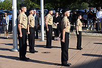 Bentonville High School ROTC students stand at attention Tuesday Sept. 7 2021 after raising a Freedom Flag at the school's 9-11 remembrance ceremony. Go to nwaonline.com/210911Daily/ to see more photos.<br />(NWA Democrat-Gazette/Flip Putthoff)