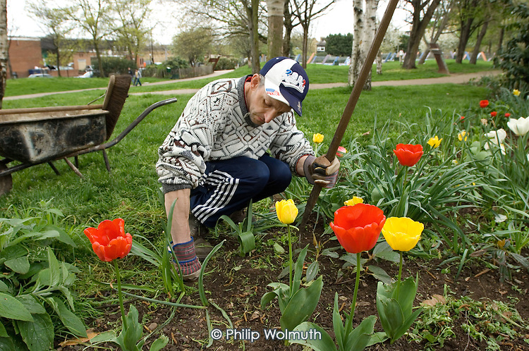 Gardener Joe Ambrosino working at Meanwhile Gardens, a community-run open space in North Kensington, London.