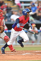 Asheville Tourists right fielder Raimel Tapia #15 swings at a pitch during a game against the Lakewood BlueClaws at McCormick Field on May 2, 2014 in Asheville, North Carolina. The Tourists defeated the BlueClaws 14-3. (Tony Farlow/Four Seam Images)
