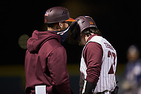 Virginia Tech Hokies third base coach Kurt Elbin (6) gives instructions to Tanner Thomas (23) during the game against the Georgia Tech Yellow Jackets at English Field on April 16, 2021 in Blacksburg, Virginia. (Brian Westerholt/Four Seam Images)