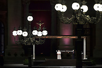 Pope Francis holds the cross as he leads the Way of the Cross April 2, 2021